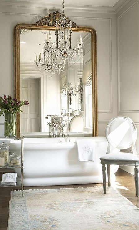 #bathroom #french #ideas #home @artisanslist ❤️ ❤️ ❤️ An elegant oval mirror gives the linear bathroom a hint of curves. Satin-nickel light fixtures on either side of the oval mirror bring additional softness to the room.