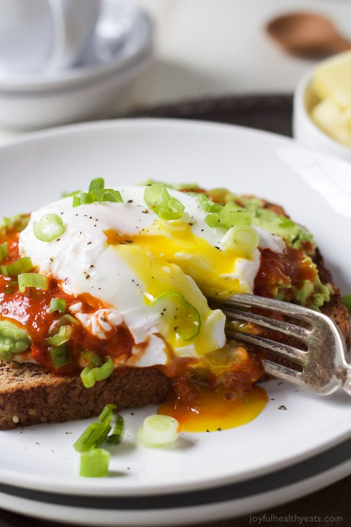 Harissa Avocado Toasts with Poached Egg - A heart-healthy breakfast packed with protein and full of flavor for only 269 calories a serving!