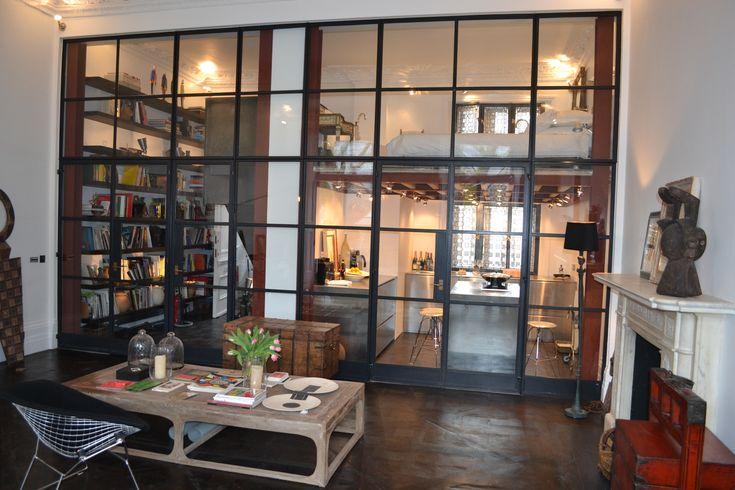 Beautiful door screen to create divide between kitchen/living space and mezzanine