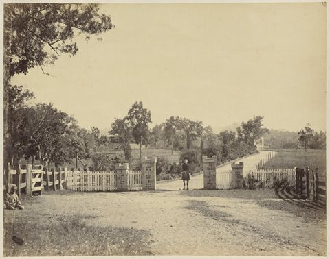 JW Lindt, 'Entrance to Yulgilbar Castle showing former King of territory [Bobby] sitting in corner on left-hand side and recent King on horseback [Edward Ogilvie]', Clarence River, New South Wales, c1872. National Library of Australia.