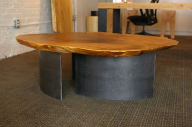 1970 Table: Aged cedar burl set on curved blackened hot rolled steel legs (18-inch and 24-inch diameter legs). This small collection of burls has been aging since the late 60's. Designed by Kirk Van Ludwig.