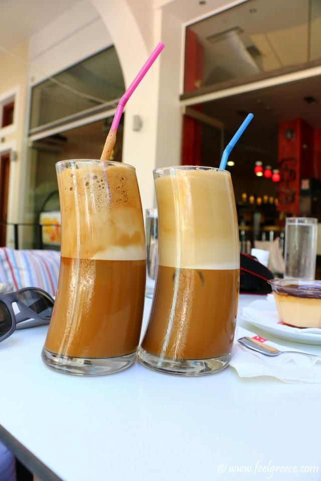Two twisted glasses of cold frappe coffee at Pylos, Messinia, Peloponnese