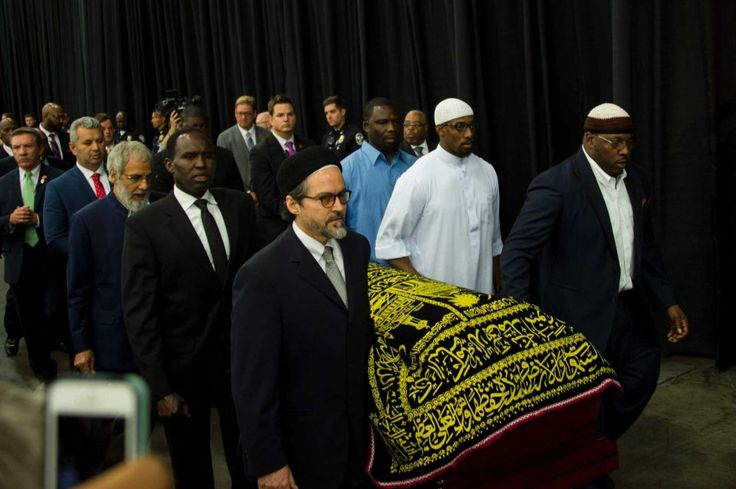 Pallbearers escort the casket of boxing legend Muhammad Ali during the Jenazah prayer service at Freedom Hall in Louisville, Ky. on Thursday, June 9, 2016.