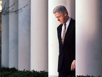 President Bill Clinton approaches the podium to make statement on the impeachment inquiry at the White House in Washington Friday, Dec. 11, 1998. Clinton apologized to the country for his conduct in the Monica Lewinsky affair.