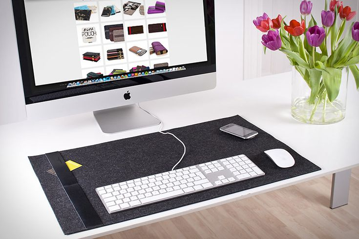 You look at it almost everyday, so you might as well like the way your desk looks. The BURNING LOVE FELT DESK PAD gives you a stylish home for all your desk peripherals — mouse, trackpad, keyboard, phone, whatever you want. The felt surface is perfect for replacing your ugly mousepad, and the leather strap gives you a convenient place to tuck important scraps of paper. Comes in a range of colors to suit your desk decor.