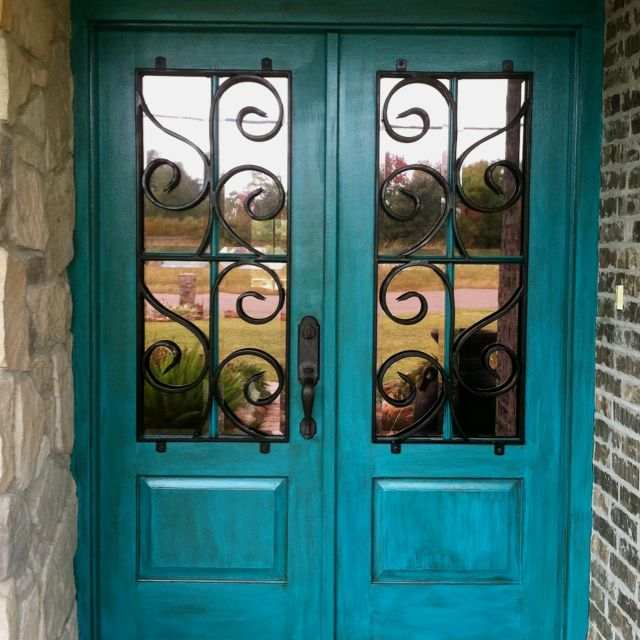turquoise doors! LOVE.......did this on my front door..first painted it black then used a large dry brush and barely any paint and dry brushed the turquoise paint to make it look weathered...used mermaid treasure color from Home Depot...