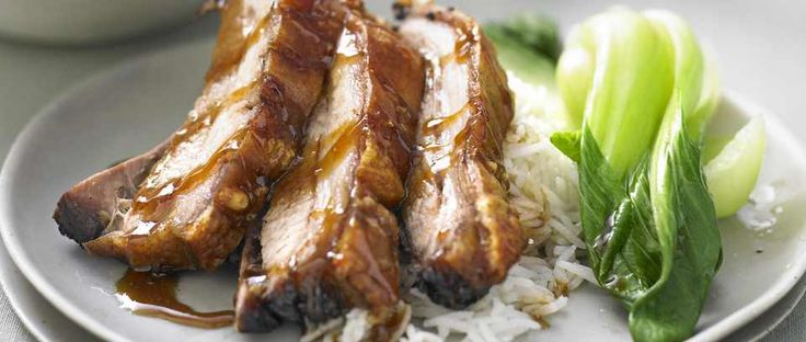 Chinese braised belly pork with greens.  This really easy Chinese recipe cooks pork low and slow in soy, 5 spice and star anise. It is all cooked in one pot so you can just put it in the oven and forget about it. Serve with rice and greens.