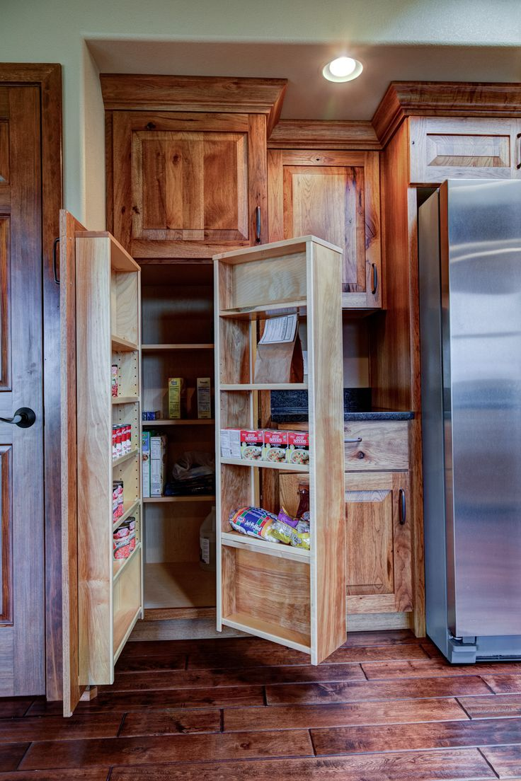 Rustic Hickory cabinets with swing out pantry.