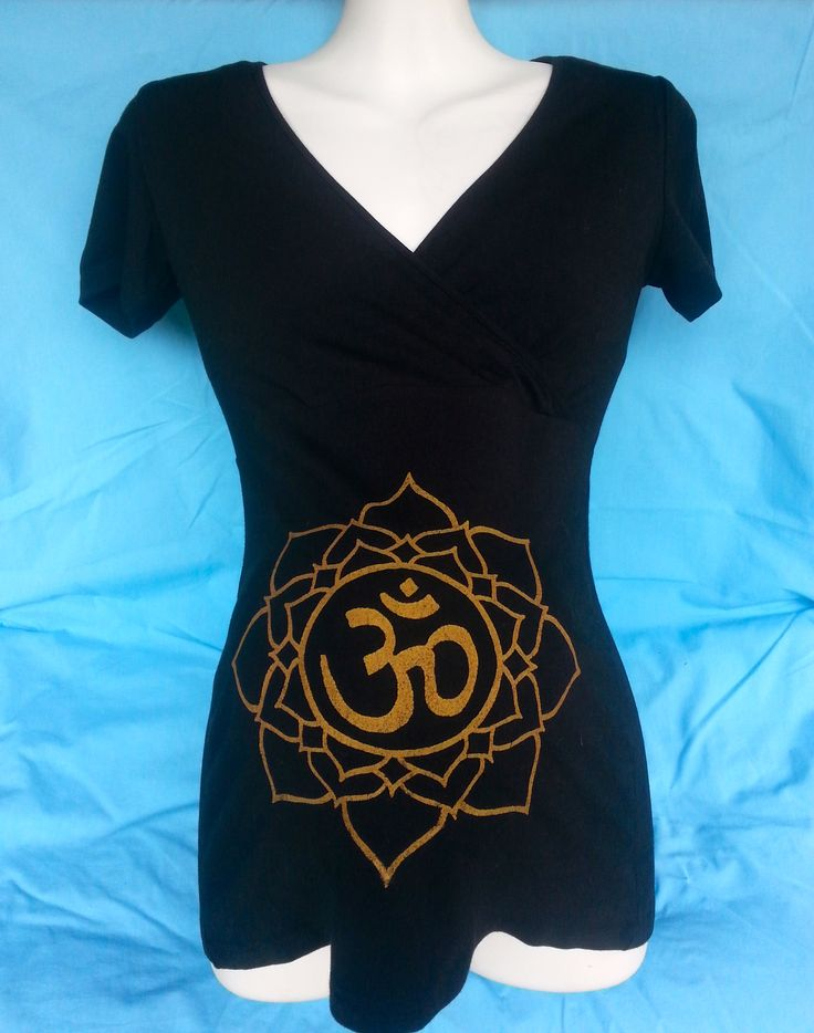 Cross-over black tee - great for breastfeeding - with golden 'om within lotus' symbol over belly. Organic Cotton/Bamboo. Fair Trade.