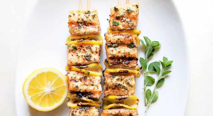 Here's a little trick: Thread salmon pieces onto two skewers so they don't flip and spin every time you turn them on the grill.