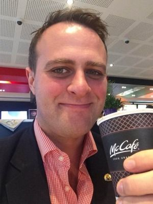"""Australian Human Rights Commissioner Tim Wilson has promoted McDonald's """"property rights"""" at the controversial Tecoma outlet by posting a Facebook ''selfie'' with a McCafe cup in hand.  Read more: http://www.theage.com.au/victoria/commissioner-champions-tecoma-mcdonalds-human-rights-20140428-zr12q.html#ixzz40ESOQZaZ  Follow us: @theage on Twitter 