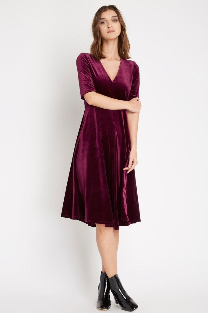 Details Soft velvet makes for a luxurious presence in this midi dress. It features elbow length sleeves and v neck leading to a fitted waist. A full swing skirt falls just below the knee for a complet