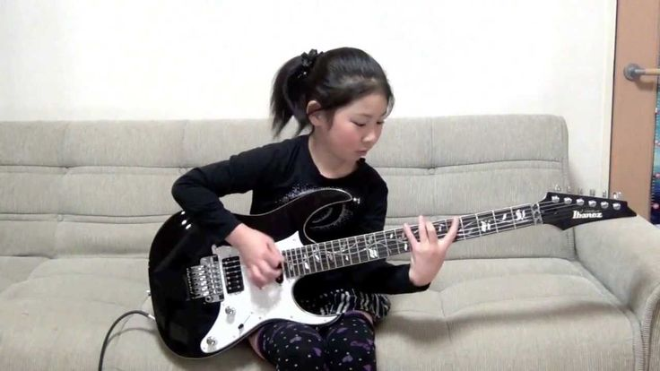 """8-Year-Old Japanese Girl Shreds on Her Electric Guitar While Playing the Heavy Metal Song """"Scarified"""" by Racer X"""