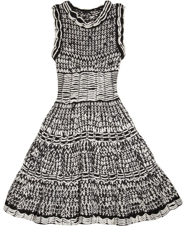 Effortless and elegant, McQ Alexander McQueen's knitted dress offers a softer take on the runway's structured silhouettes. This tactile piece was crafted on an extremely rare knitting machine in Italy that replicates hand-weaving techniques to create highly complex patterns and designs.