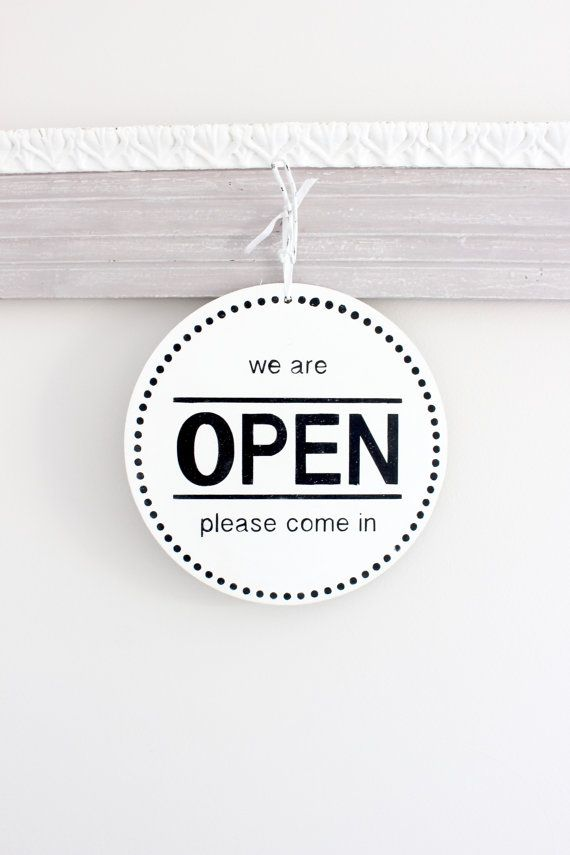 Business/Store Sign: Open/Closed with a modern design.  THIS SIGN: *Measures 10 round and 1/8 thick. (Very light weight) *Available with jute or white ribbon for easy hanging (Choose in drop down when ordering.) *Sample sign is done in Bright White with Black for the text  The front of this sign is We are Open, Please Come In and on the reverse side Sorry, we are Closed Please come back later. Great sign for any business to hang on the door or in the window.  This sign is completely hand…