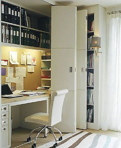 Great use of space in this multi-purpose office closet  note binder space, drawers, and side shelving! home-office_closet1