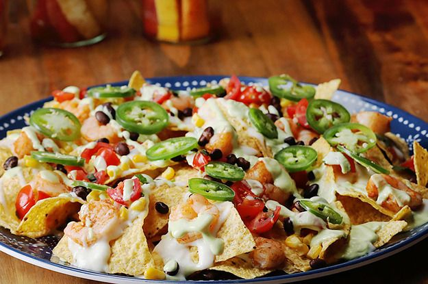 Get the fiesta going on Cinco De Mayo with firey, Spicy Shrimp Nachos topped with a zesty, lime-yogurt drizzle made with Chobani Non-Fat Plain Greek Yogurt. http://cho.ba/2njAxBC