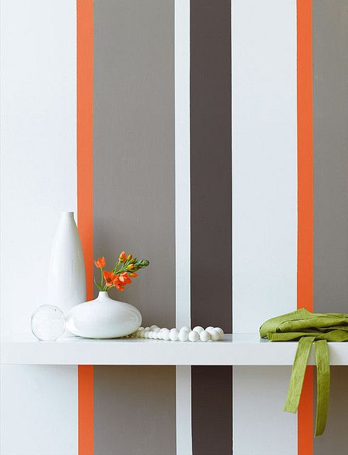 orange, white, grey vertically striped wall I'm loving this idea for the accent wall in the sitting room!