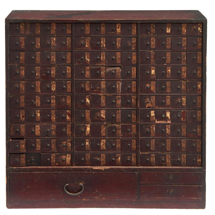 Medicine chest (kusuridansu) made from hinoki cypress wood. Configuration from above: ten rows with twelve small drawers each with a pasted paper label on which the name is written of a particular herb or other substance used in traditional medicine. Below: one wide drawer and two smaller drawers. Late Edo - Bakumatsu period. Size;H. :…