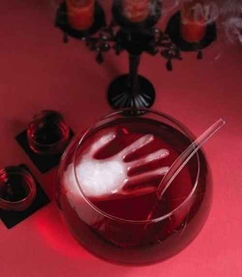 Use a rubber glove to make a creepy ice cube. | 27 Incredibly Easy Ways To Upgrade Any Halloween Party