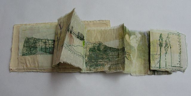 Grassland Book by Cas Holmes, 2011. Folding book from with found materials and print. Use of stitch as a line of drawing. 12x60cm. Textiles mixed media