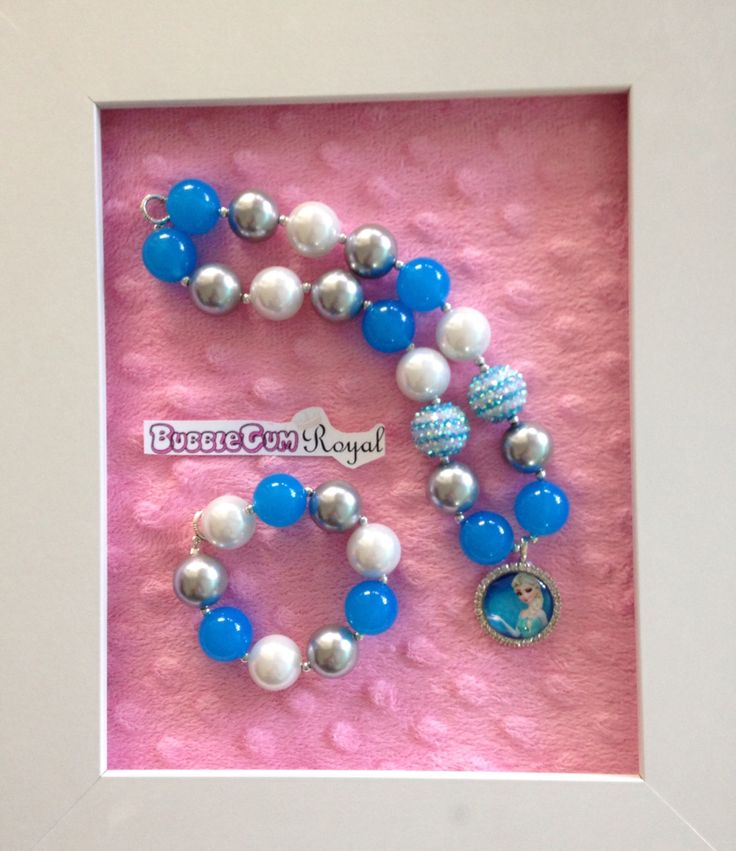 Princess Elsa inspired bubblegum bead necklace with blue, white and silver beads with an Elsa pendant $20 + p&h. Matching bracelet $5 with necklace purchase.