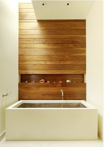 Wood slatted wall with varying sized strips & a small display niche. Adds scale, warmth & softness.
