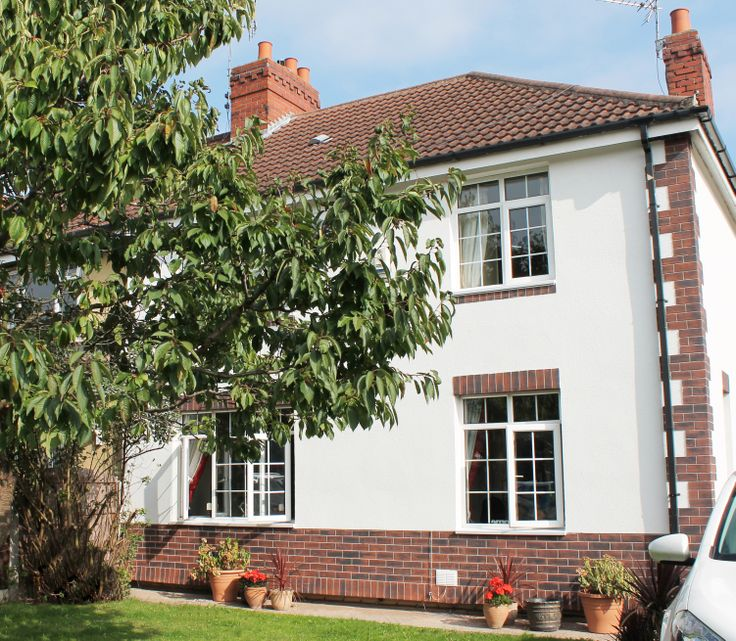 NWS - External Wall Insulation - White Acrylic, Quoin Feature, 1m High Brick Effect Render, Cut Render To Window Cills And Heads.