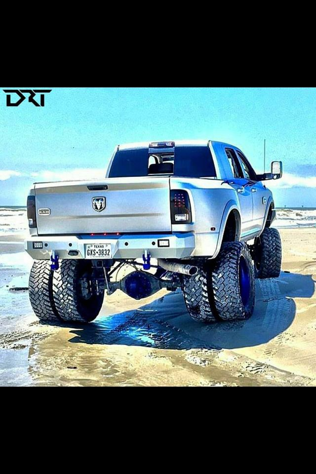Just playing in the sand.... Silver Dually Lifted Dodge Cummins