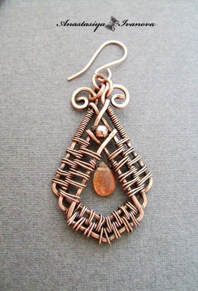 Elegant multi-layer wire weaving design.  Very pretty but a more colorful stone would enhance these even further.