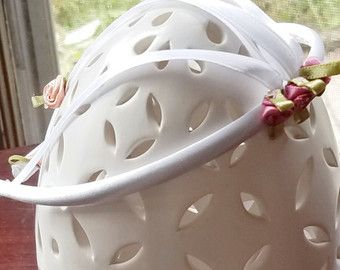 For a special occasion or making a statement this beautiful flower headband is the perfect accessory! A dusty pink and white polka dot headband accented with multiple lace and ribbon flowers. This neutral headband is just perfect to pair with a dress or jeans and a sweater.  Headband size is perfect for girls ages 2 - 13!  Ask me about gift wrapping!  This headband will ship in a 6x6x6 inch box to protect the flowers and keep its shape.  Visit my shop home page to view my full selection…