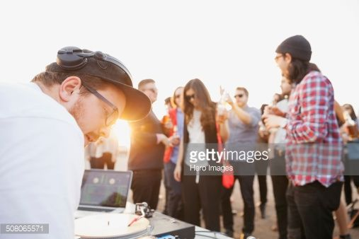 Stock Photo : DJ playing music at rooftop party