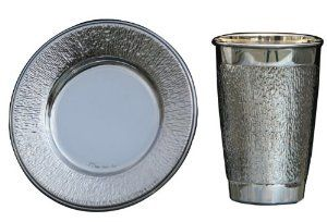 Silver Plated Kiddush Cup with Saucer and Rough Texture by World of Judaica. $57.00. Your order includes 1 item(s).. Dimensions: 9cm. Material: Silver Plated. You will be pleasantly surprised! The vast majority of our shipments arrive within 10-14 business days from time of shipment, far in advance of Amazon's default calculation of shipping times for items shipped from Israel.. This set of Kiddush cup and saucer bear a simply design of rough texture on its surface...