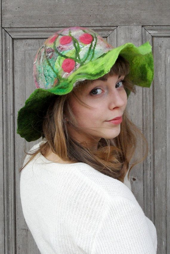 Unique and elegant felted hat in bohemian style with large wavy brim. Its made nuno felt technique with silk fabric and merino wool, decorated with