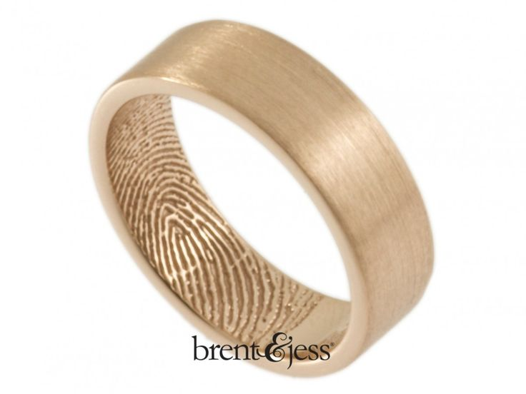 This warm-toned wide wedding or commitment band is handcrafted in 14k rose gold, with your loved one's fingertip print on the inside.  This is a beautiful alternative to ouroriginal wrapped style, particularly if you'd like somethingengravednext to the fingerprint. There is plenty of room for 12 characters and spaces, so you can let your imagination run wild with sentiment.We can add your ownhandwritingfor an extra special touch. Our rings are also available in sterling silver,...