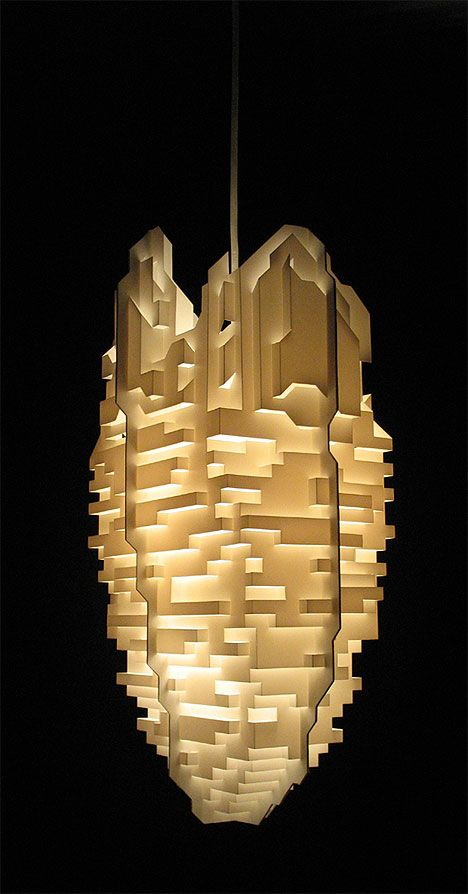 Cloud City is a new pendant lampshade by Phil Cuttance, inspired by paper folding techniques found in pop-up books. The die-cut polypropylene shade folds flat, but then takes it form when placed over a bulb. In all its 360º glory, Cloud City evokes images of a pixelated city in the clouds.