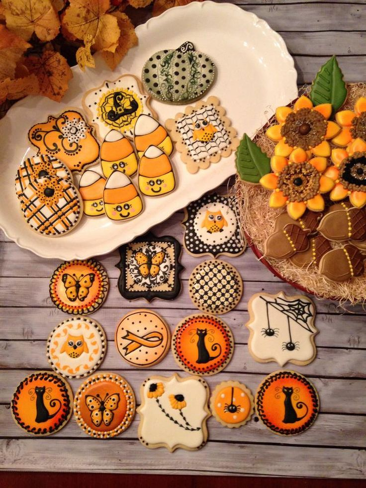 Halloween assortment by Sweet hill cookies posted on Julia Usher's Cookie Connection http://cookieconnection.juliausher.com/clip/halloween-32 Candy corn, pumpkin, orange & black butterfly, black cat, sunflowers, acorns, cute spiders, more ... .