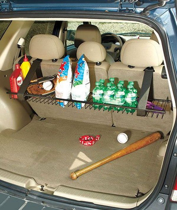 You can design a sturdy metal rack hanging from the rear seat of your vehicle with fabric magic straps. It is a storage of grocery bags, sports equipment, drinks and more. Besides, you can fold it up when not in use so that it is out of the way against the back of the seat. http://hative.com/storage-organization-ideas-for-your-car/