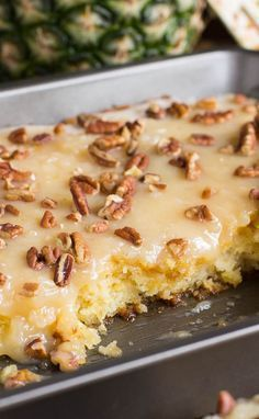 """This Pineapple Sheet Cake is the perfect twist on a summer dessert! From """"Spicy Southern Kitchen"""", this cake is flavored with pineapple, topped with coconut icing, and will be enjoyed by all."""