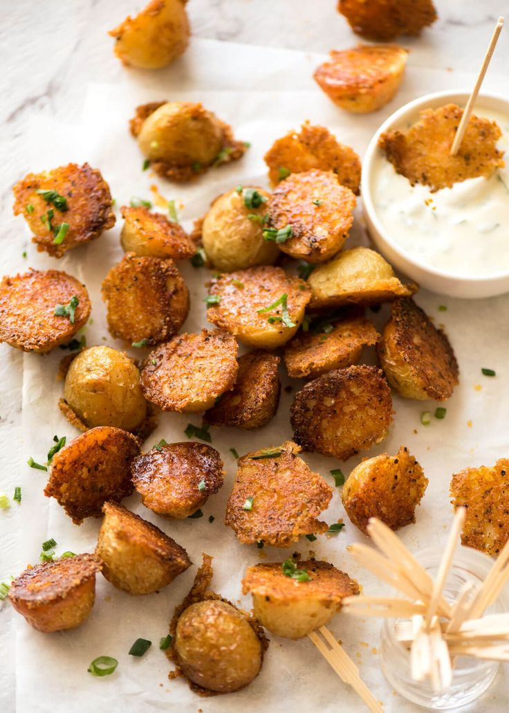 Make these Crispy Roasted Parmesan Potatoes for your Sunday roast or pass them around at a party! www.recipetineats.com