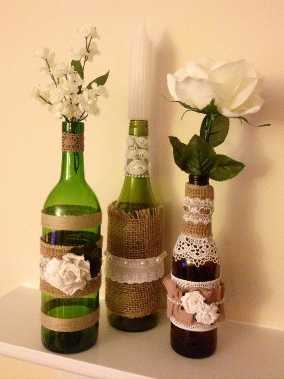 16 best images about wine bottle centerpieces on pinterest for Glass bottle centerpieces