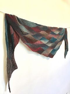 """Carol's frequency uses frequent short row turns with a technique called """"Knit the Turn"""" that eliminates the need for wraps at each turn. This allows you to move quickly creating waves of color that shift as you move through this captivating pattern."""