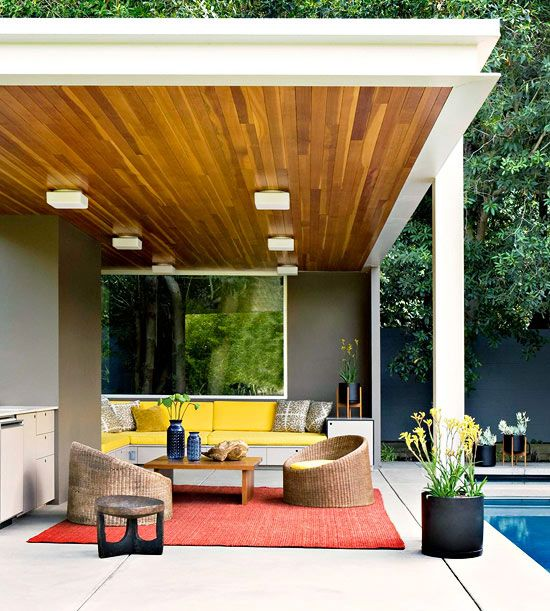 Sunny yellow accents add a pop of color to this sleek, modern porch. See more ways to create an outdoor porch retreat:http://www.bhg.com/home-improvement/porch/porch/outdoor-porch-design-and-decorating/?socsrc=bhgpin060113modern=15