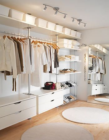 ikea closet. Ive been thinking of putting this in Katelyns room along one wall and putting shelving on top instead of hanging clothes...Hmmmm