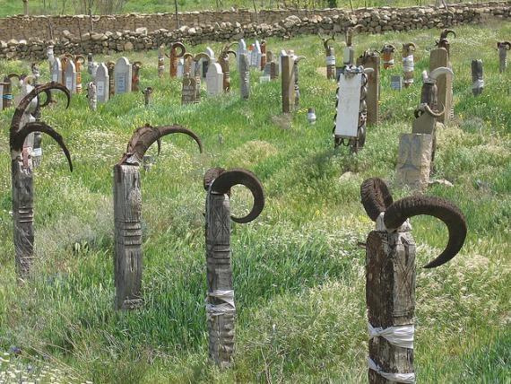 Nokhur cemetery with goat-horn adorned gravestones