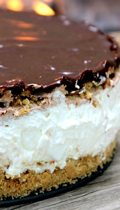 S'mores No Bake Cheesecake - the filling of this no-bake cheesecake uses cool whip and  marshmallow fluff to keep it light but still taste like a real s'more.  Idea to take it one step further: stick mini marshmallows around the outside of the filling and use a kitchen torch to toast them!