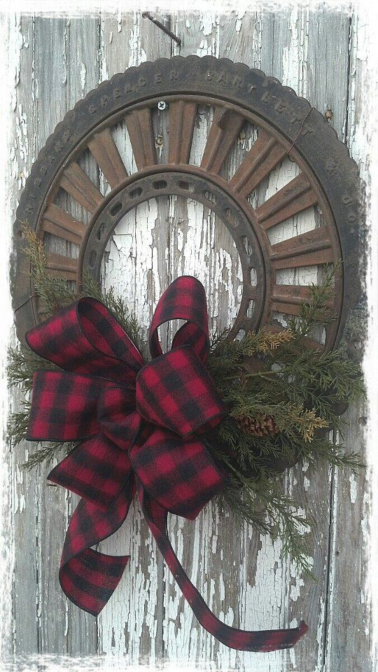Christmas Wreath...Old Farm Machinery Piece...repurposed into a rusty rustic wreath with plaid bow & greens.