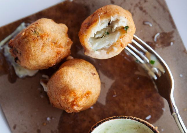 Blue Crab Beignets ~ Using the best and freshest crabmeat you can get your hands on makes all the difference in these lightly battered and totally addictive fritters from La Petite Grocery, a new-school NOLA bistro. #New_Orleans #La_Petite_Grocery
