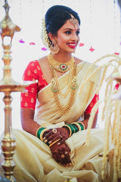 South Indian bride. Gold Indian bridal jewelry.Temple jewelry. Jhumkis. Cream silk kanchipuram sari.Braid with fresh jasmine flowers. Tamil bride. Telugu bride. Kannada bride. Hindu bride. Malayalee bride.Kerala bride.South Indian wedding.