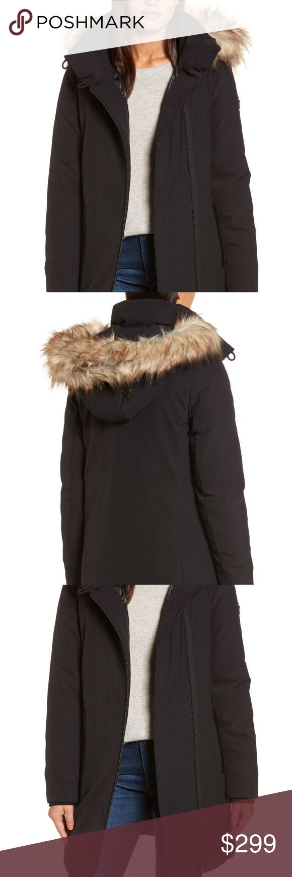 "NWT DKNY Black Hooded Parka Size Small Faux Fur A ruff of soft faux fur trim traces the removable hood of a down-and-feather insulated parka made from stretch nylon for a comfortable fit.  The fur is black on the actual coat, not the brown.  DKNY Bag is included.  DKNY Hooded Water Resistant Stretch Parka with Faux Fur Trim  Bust: 33.5""- 35.5"" Waist: 26-29"" Hip: 36-39"" DKNY Jackets & Coats Puffers"